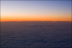 Sunset over the clouds from the plane
