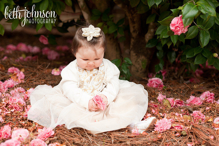 baby girl holding pink flowers maclay gardens tallahassee photographer