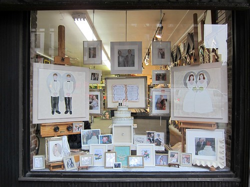 Celebration of same-sex weddings in random East Village frame store