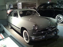 gaz-21(0.0), automobile(1.0), automotive exterior(1.0), 1949 ford(1.0), vehicle(1.0), mid-size car(1.0), compact car(1.0), antique car(1.0), sedan(1.0), classic car(1.0), vintage car(1.0), land vehicle(1.0), motor vehicle(1.0),