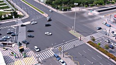 controlled-access highway(0.0), residential area(0.0), car park(0.0), overpass(0.0), race track(0.0), traffic congestion(0.0), neighbourhood(0.0), metropolitan area(1.0), asphalt(1.0), highway(1.0), traffic(1.0), junction(1.0), road(1.0), lane(1.0), aerial photography(1.0), road surface(1.0), street(1.0), pedestrian(1.0), infrastructure(1.0), intersection(1.0),