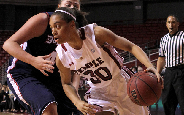 Temple's #30 Freshman Guard Monaye Merritt and Duquesne's #44 Junior Forward Carly Vendemia