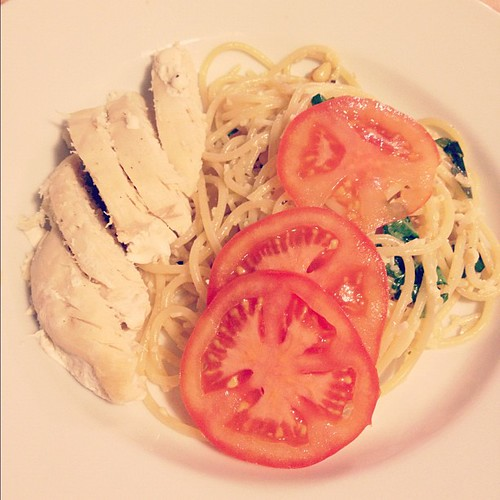 Tonight's dinner. Lemon garlic pasta garnished with tomatoes and served with sliced chicken breast. #food #yummy