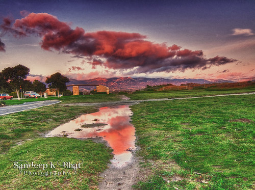california cars santabarbara clouds canon reflections puddle university entrance santaynez hdr ucsb s90 henleygate
