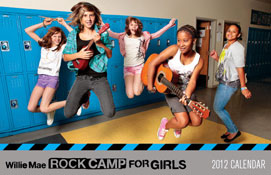 This calendar shows a group of teenage girls holding jumping into the air. There are five girls total, and the two in the front are holding a ukulele and a guitar. They're in what appears to be a school hallway, as their is a long line of lockers behind them. The bottom of the calendar reads Willie Mae Rock Camp for Girls 2012 Calendar.