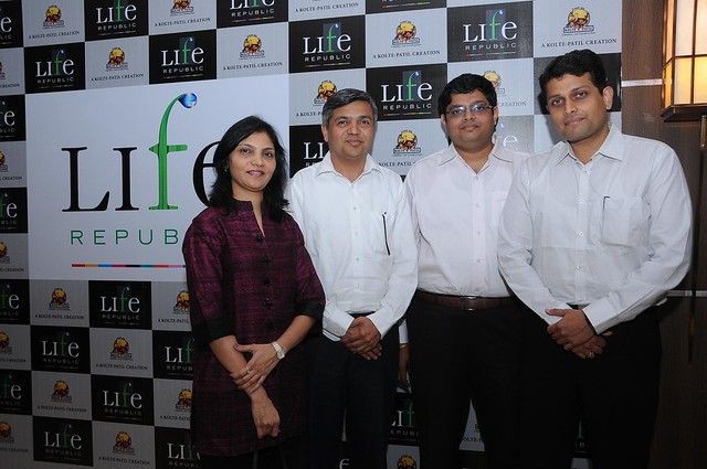 Sunita Kolte, Executive Director, Rajesh Patil, Chairman and Managing Director, Sujay Kalele, Vice President, Business Development of Kolte-Patil Developers Limited and Vijay Sane, Project Director, Kolte-Patil I-ven Townships (Pune) Pvt. Ltd.