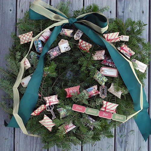 Step 6:  Trim ribbon and affix die cuts and tags to embellish the wreath.