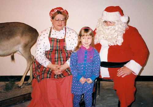 Christina (3 1/2) with Santa and Mrs. Claus at the zoo museum, 1993..