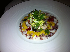 Octopus carpaccio, orange and ginger salsa with goujons and rocket