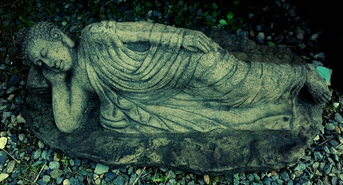 Reclining Buddha in robes, green toned, concrete statue, Lake City Way, Seattle, Washington, USA by Wonderlane
