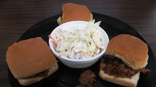 Pulled pork sliders and cole slaw by Coyoty