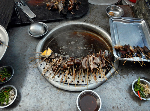 Yangon street food: unknown meat being cooked in an unknown broth