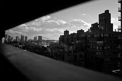 Brooklyn Bridge and south Manhattan's roofs from Manhattan Bridge