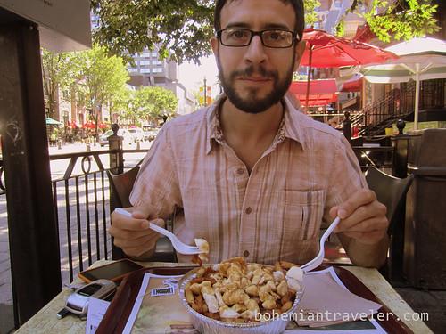 Stephen eating poutine
