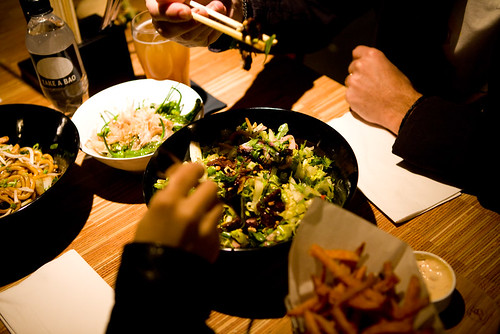 menu items (left to right: chicken basil stir fry, shashito peppers with bonito flakes, steak salad, sweet potato fries) by TAKE A BAO