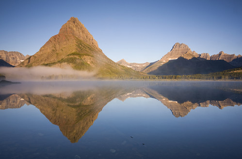 morning mist lake mountains reflection nature fog sunrise canon landscape mirror amazing montana quiet peace foggy glacier huge glaciernationalpark alpen towering 2010 gnp swiftcurrent swiftcurrentlake manyglacier grinnellpoint