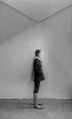 white(1.0), snapshot(1.0), photograph(1.0), light(1.0), monochrome photography(1.0), standing(1.0), monochrome(1.0), black-and-white(1.0), shadow(1.0), black(1.0),