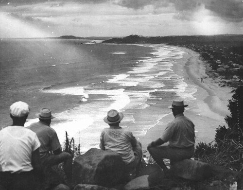 Four men looking out at the sea at Palm Beach, Gold Coast,