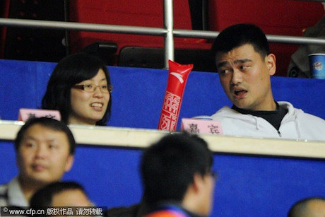 December 14th, 2011 - Yao Ming and wife Ye Li attend a Shanghai MAXXIS Sharks game