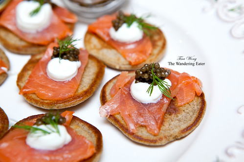 Homemade buckwheat blini with crème fraîche, salmon fume, Imperial Beluga Kaluga caviar and dill
