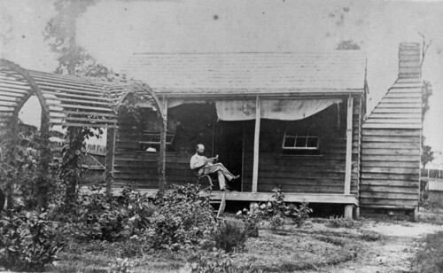 Reading the paper in a Gympie garden, ca. 1871