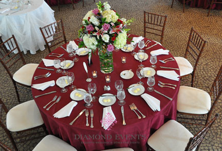 Table setting with floral arrangment at Whitehall Manor by Diamond Events
