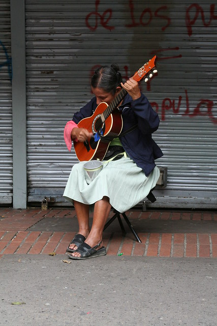 Guitar and woman sharing 2