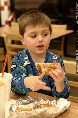 eating the grilled cheese menu option at five guys burger and fries    MG 3031