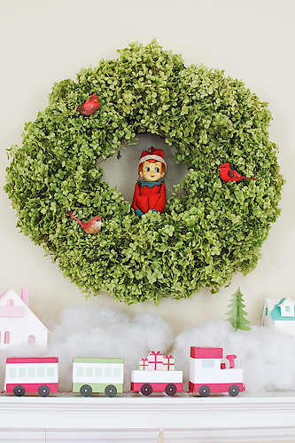 Elf in a wreath.