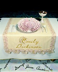 Place setting at the dinner party, with Emily Dickinson's name embroidered on the napkin