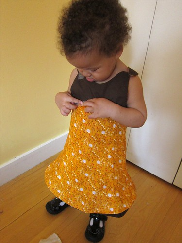 Ms. Z tries on her half-finished Tea Party Sundress.