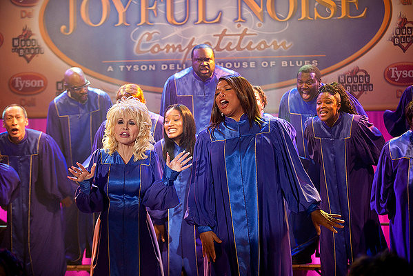 Dolly Parton and Queen Latifah sing joyfully when they should really be lamenting why God punished them by putting them in this movie.