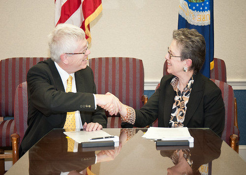 "Trevor Nichols (left), Chief Executive Officer, Centre for Agricultural Bioscience CABI-Plantwise and Dr. Catherine Woteki (right), Undersecretary, Research Education and Economics signed a Memorandum of Understanding to make the United States Department of Agriculture's research and genetic information accessible to ""plant doctors"" working to prevent disease and pests in developing countries at the United States Department of Agriculture in Washington, D.C., on Tuesday, February 7, 2012."