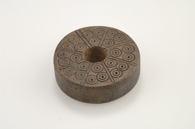 Spindle whorle with circular ornaments