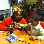 El'shah, home for Easter Holiday assist Tamia with solder class.