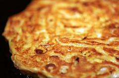 pizza cheese(0.0), produce(0.0), dessert(0.0), meal(1.0), breakfast(1.0), murtabak(1.0), roti prata(1.0), baked goods(1.0), zwiebelkuchen(1.0), food(1.0), dish(1.0), cuisine(1.0), potato pancake(1.0), quiche(1.0), tortilla de patatas(1.0),