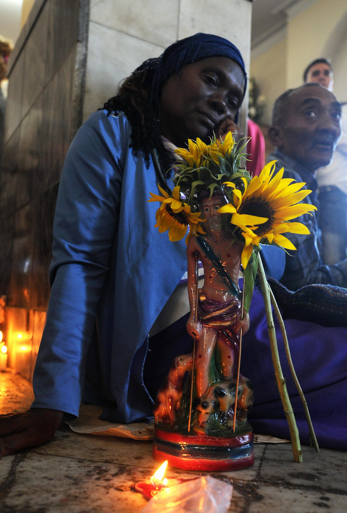 A Cuban pilgrim honors Babalu Aye (San Lazaro)