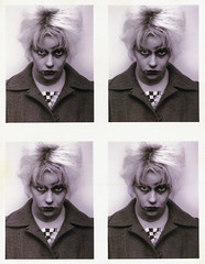 one of the girls as Myra Hindley in a mug shot looking at the camera