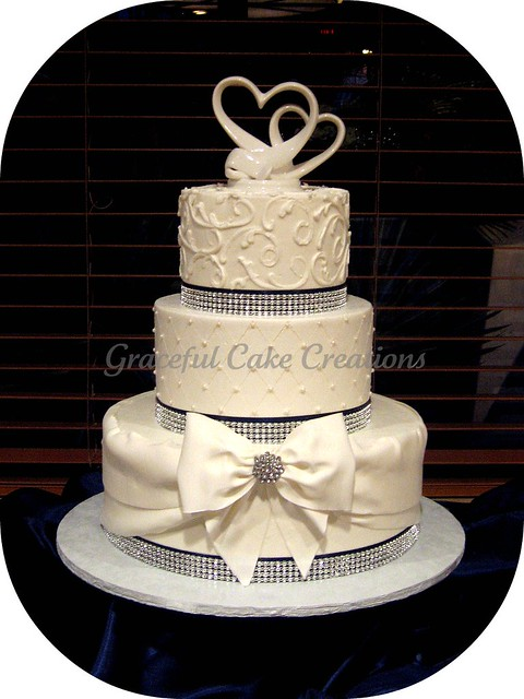 Elegant White Wedding Cake with Crystal Ribbon and Navy Blue Accents