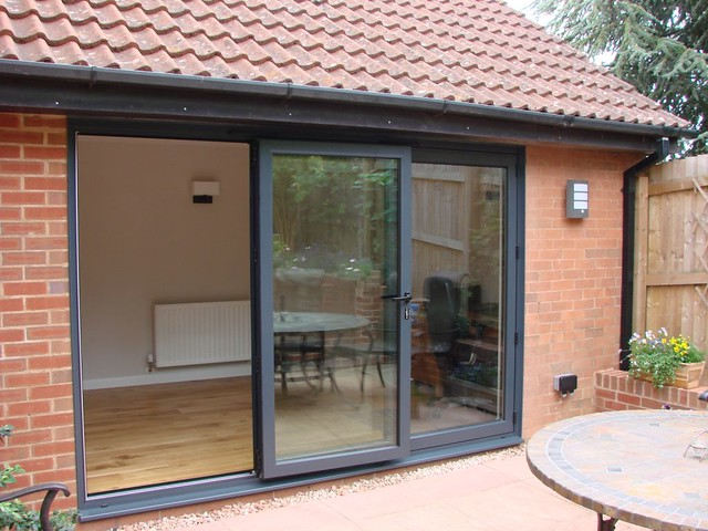 <p>Created sun room out of half of double garage with bi-fold door.</p>