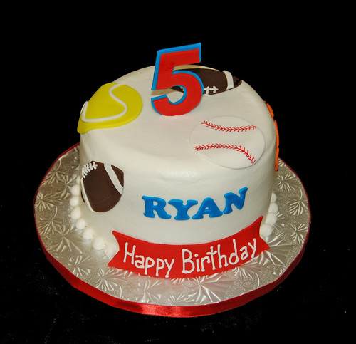 5th birthday sports themed cake - football, baseball, tennis, basketball