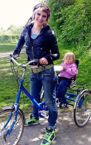 Jessika with her friend's daughter, on Pashley Picador.