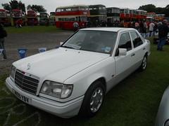 mercedes-benz w201(0.0), automobile(1.0), automotive exterior(1.0), vehicle(1.0), mercedes-benz w124(1.0), mercedes-benz(1.0), mercedes-benz 500e(1.0), bumper(1.0), sedan(1.0), classic car(1.0), land vehicle(1.0), luxury vehicle(1.0),