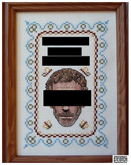 cross stitch of Hugh Laurie from House with his eyes blacked out
