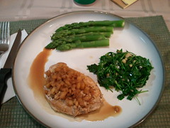 Balsamic citrus glazed pork chop, wilted arugula salad, and asparagus