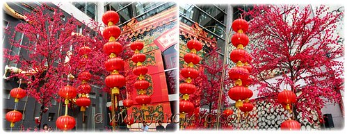 CNY 2012 decor: giant cherry blossom trees and red lanterns at entrance to Pavilion KL #1/2