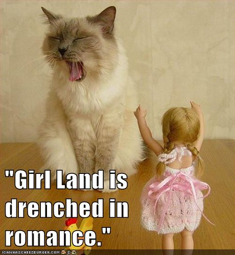 cat growling, quote reads Girl Land is drenched in romance.