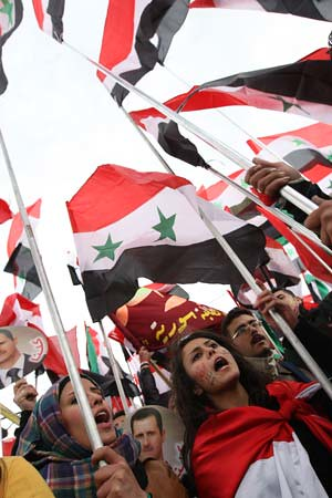 Supporters of the Syrian government stand strong against imperialist destabilization. A United Nations Security Council resolution against Syria was vetoed by Russia and China. by Pan-African News Wire File Photos