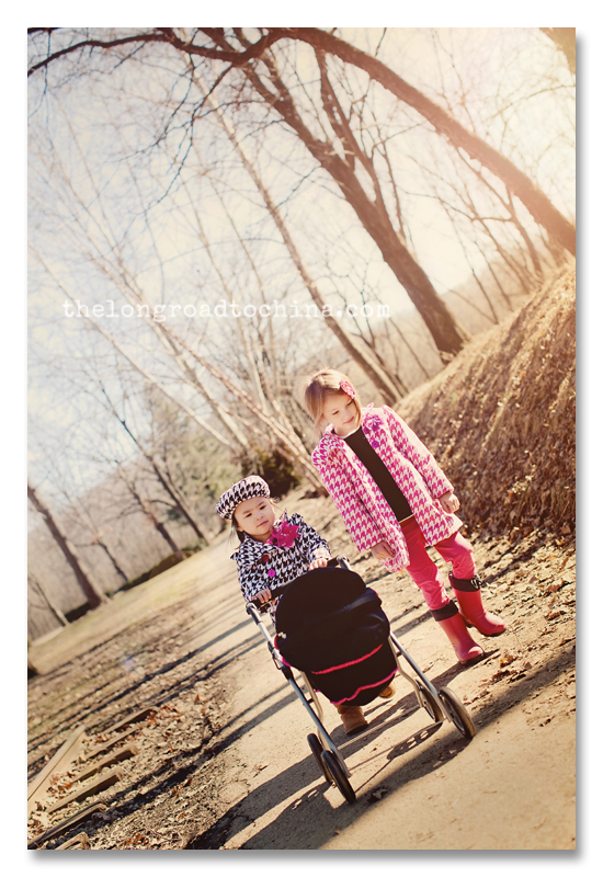 Two girls pushing the baby carriage BLOG