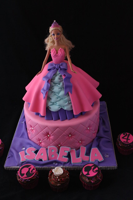 Doll cake with matching cupcakes